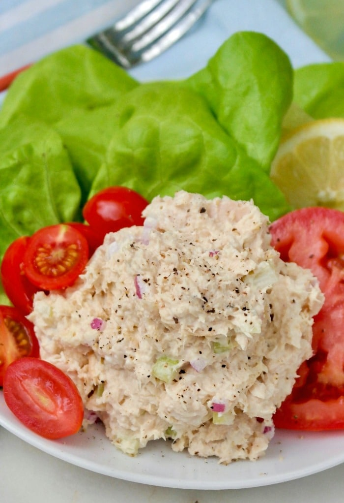 Low carb tuna salad with tomatoes on a white plate.
