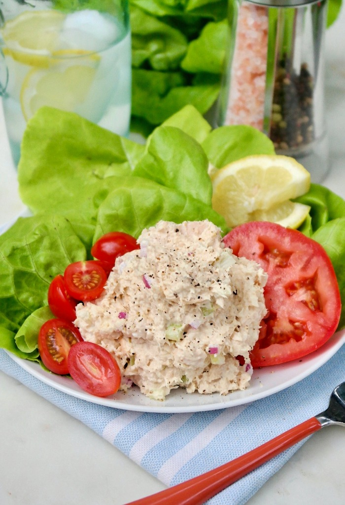 A scoop of keto tuna salad on a white plate ready to eat.