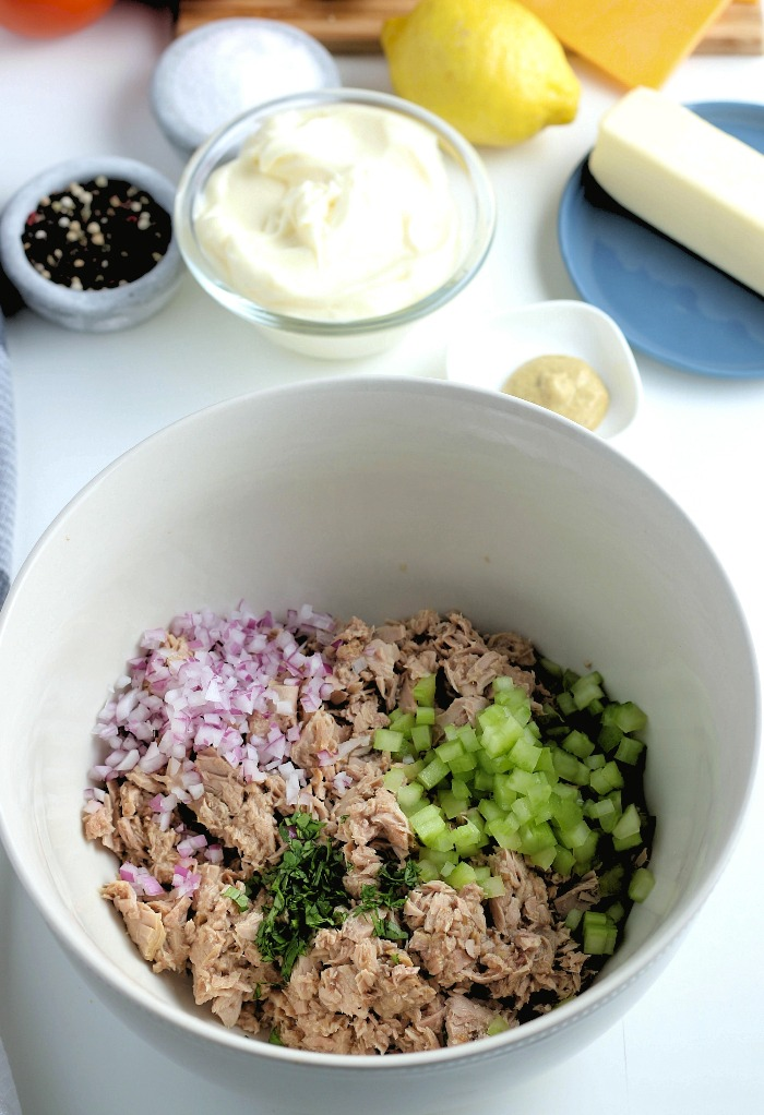 Tuna salad ingredients in a large mixing bowl.