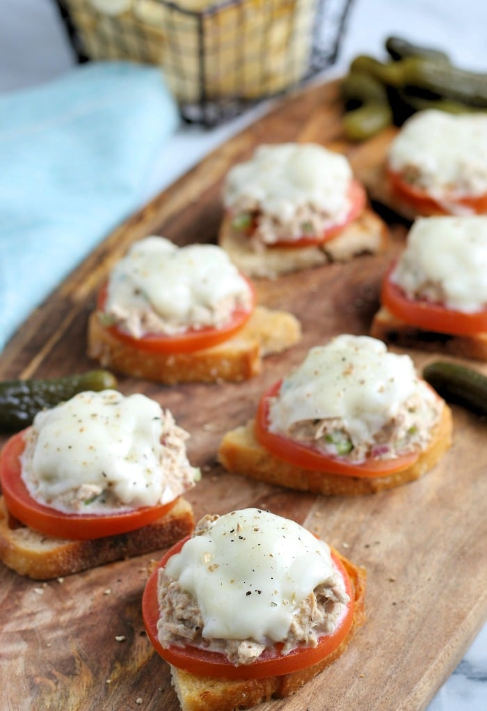 Tuna on toast topped with tomato and melted cheese