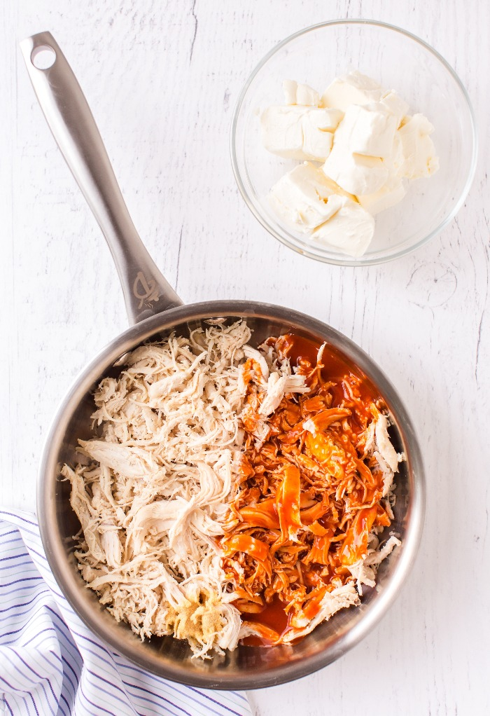 Shredded Chicken in a pan with cayenne sauce