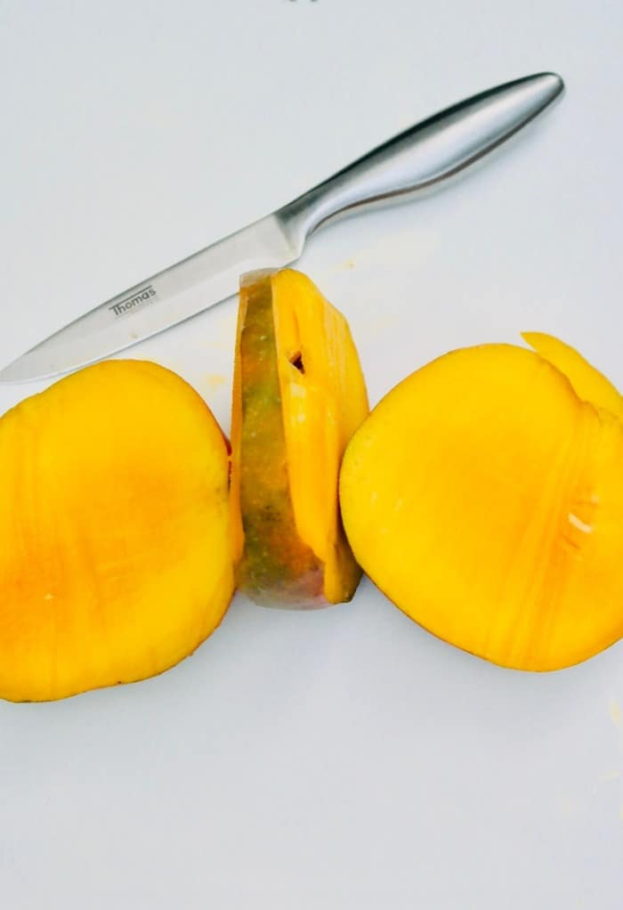 Fresh mango sliced avoiding the pit.