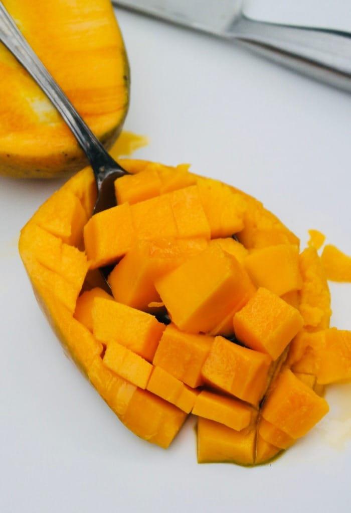 Half of a mango cut into chunks.