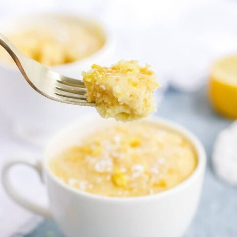 A forkful of keto lemon mug cake right out of the white mug.