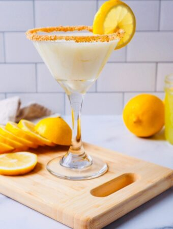 Limoncello martini on a cutting board with lemon slices