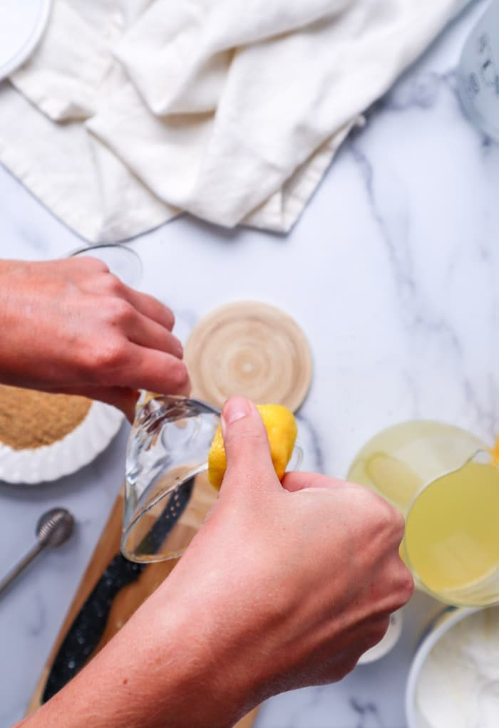 Add lemon juice to a rim of a martini glass before dipping in graham cracker crumbs