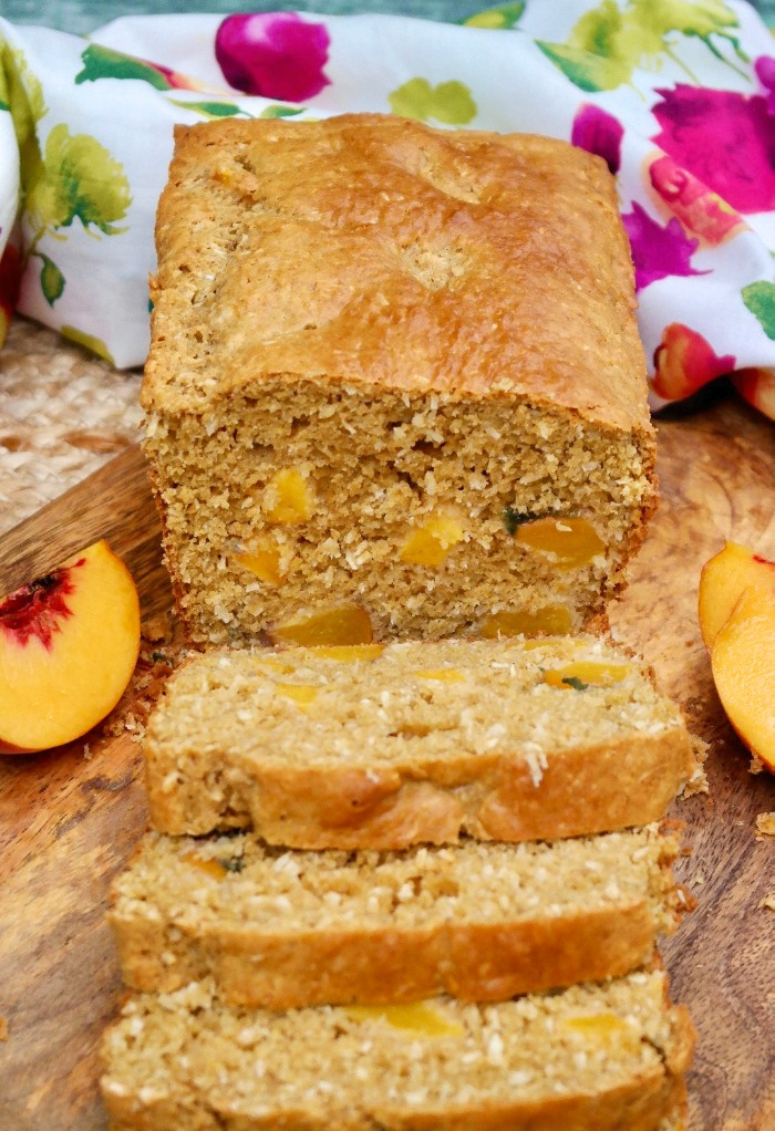 Homemade peach bread on a cutting board