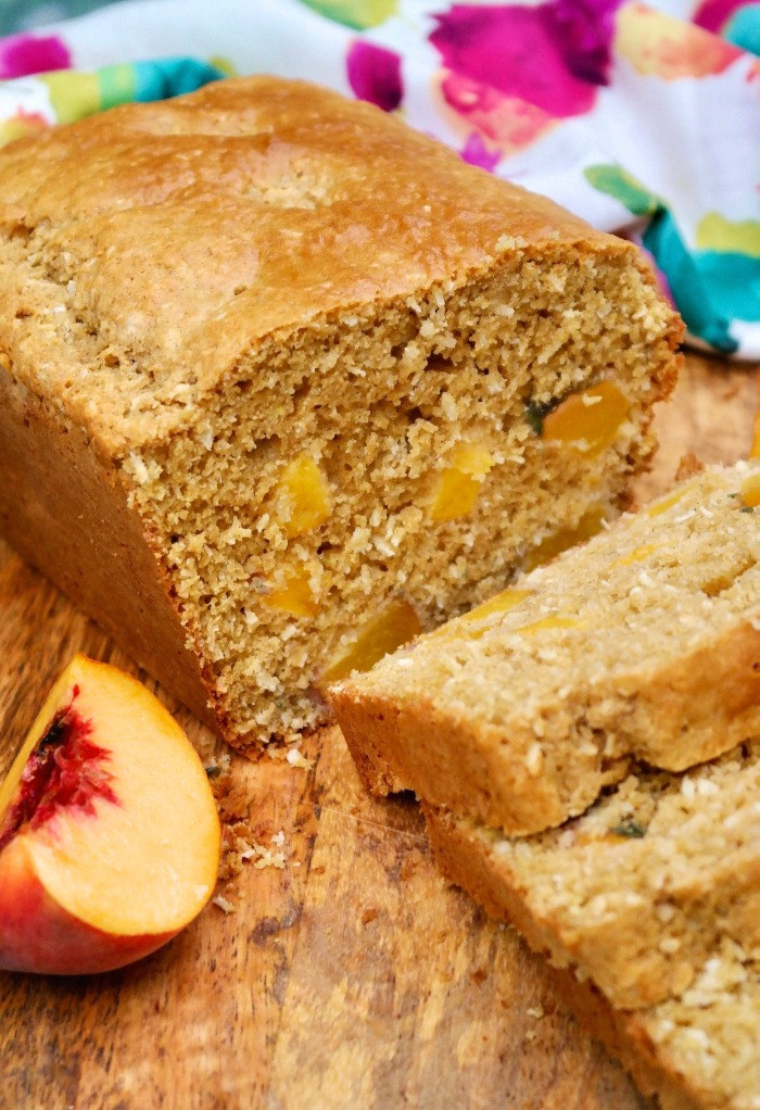 Homemade peach bread sliced on a cutting board