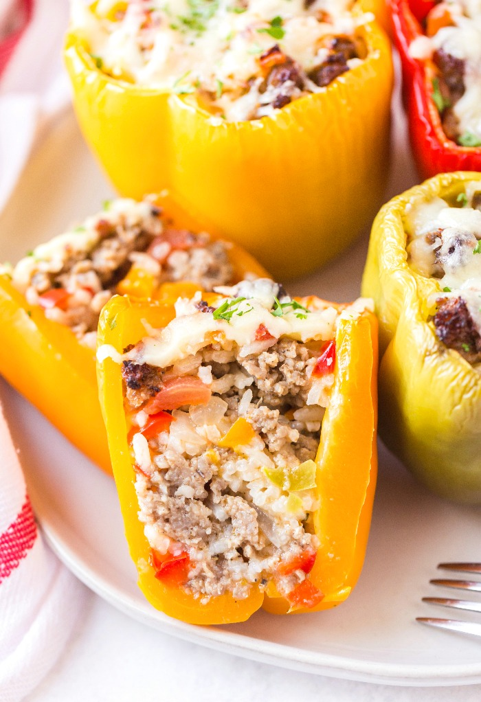 Yellow bell pepper stuffed and cut in half