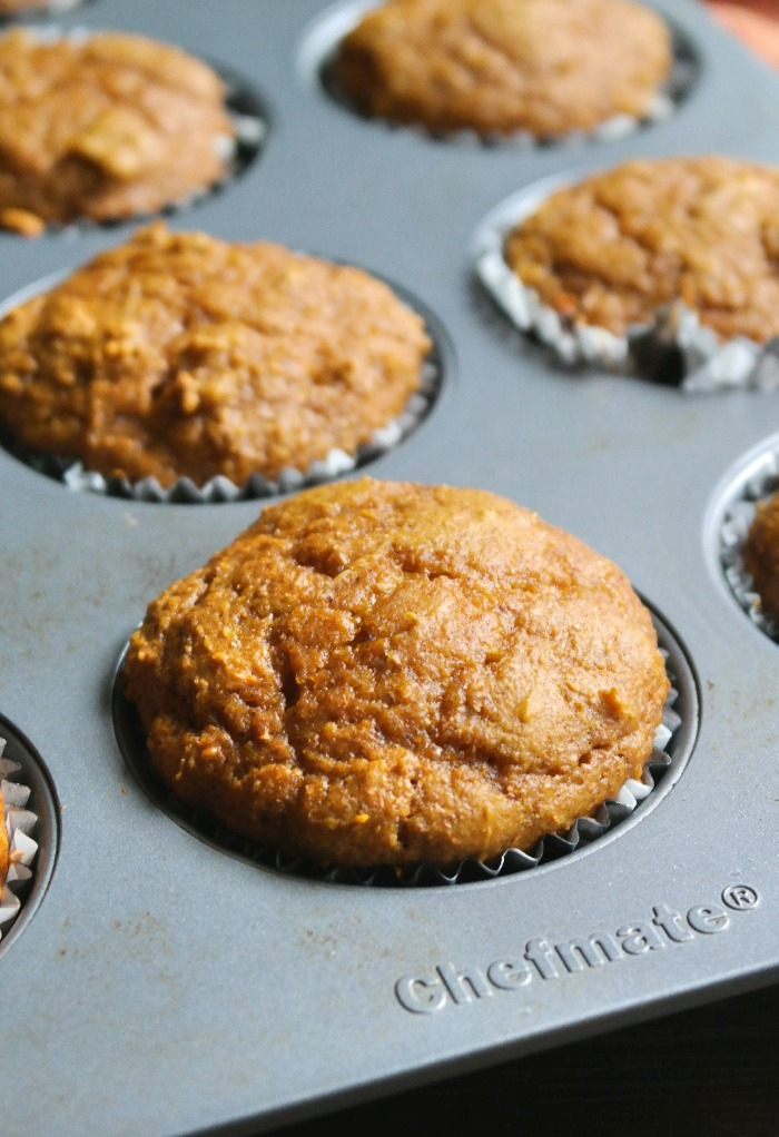 Baked pumpkin protein muffins in a baking pan.