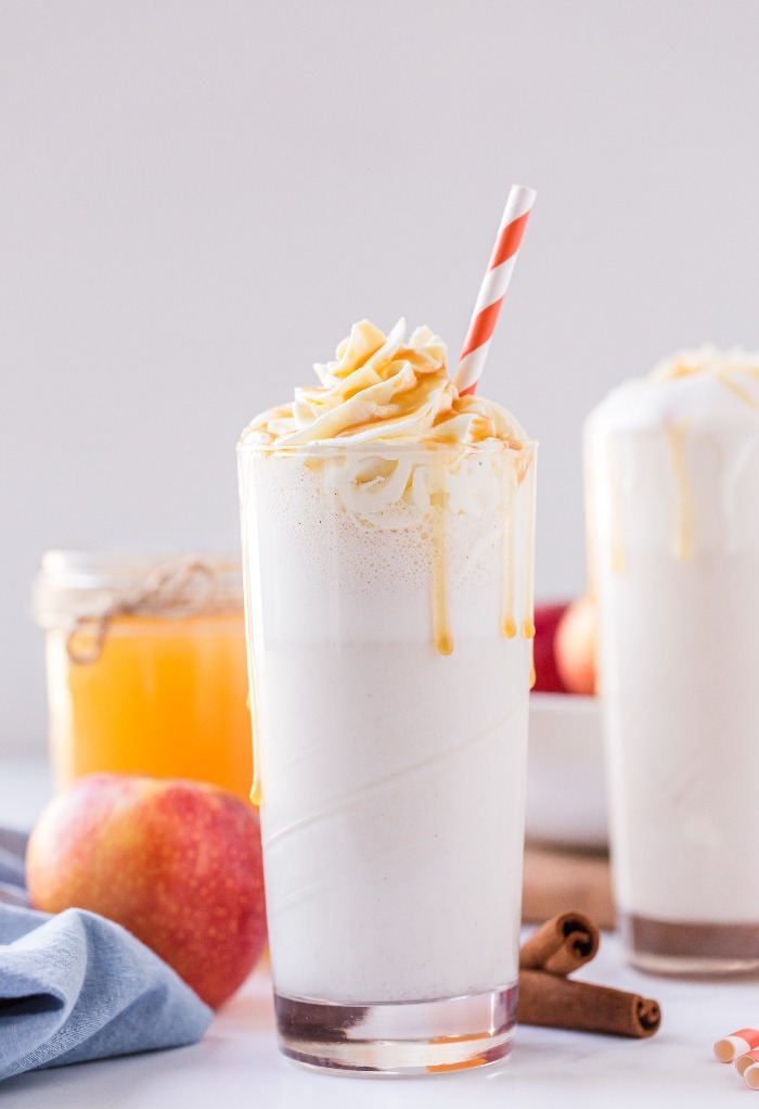 Apple cider milkshake topped with whipped cream and caramel topping.
