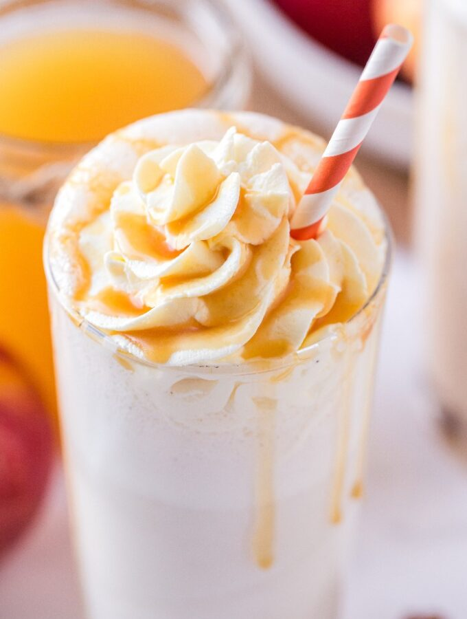 A homemade apple milkshake topped with whipped cream ready to be enjoyed.