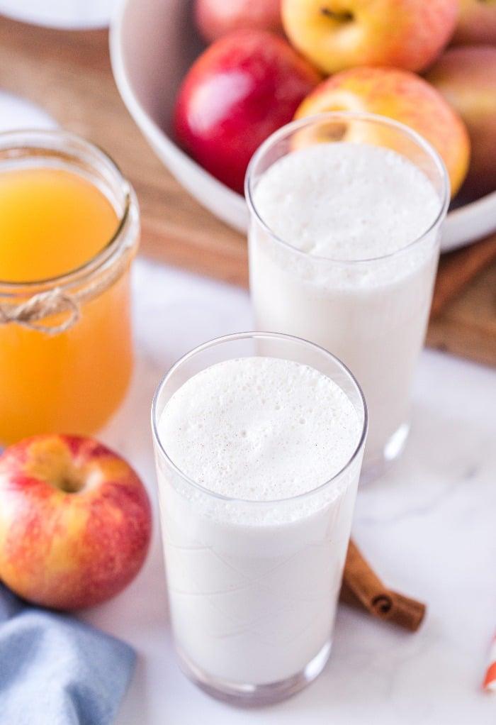Blended vanilla milkshake in clear glasses.
