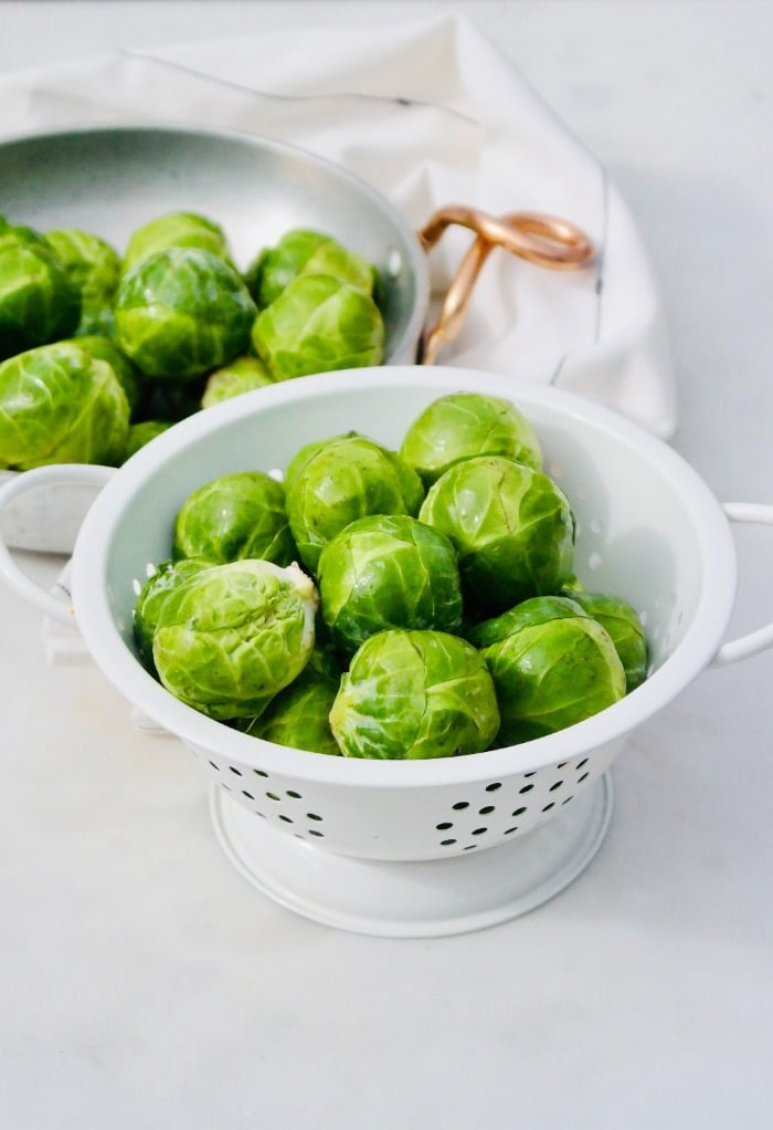Here are brussels sprouts in a colander after being cleaned.