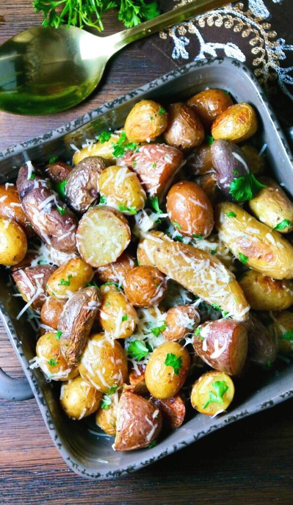 A top view of potatoes in a gray serving dish ready to be served.