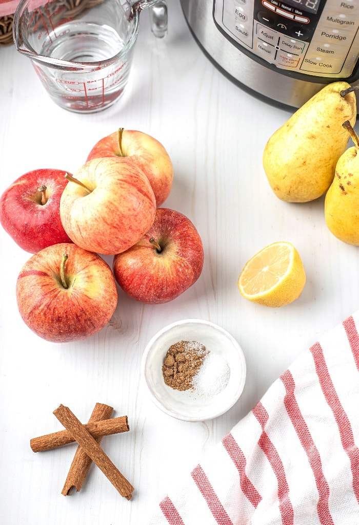 All the ingredients needed to make applesauce in an Instant Pot.