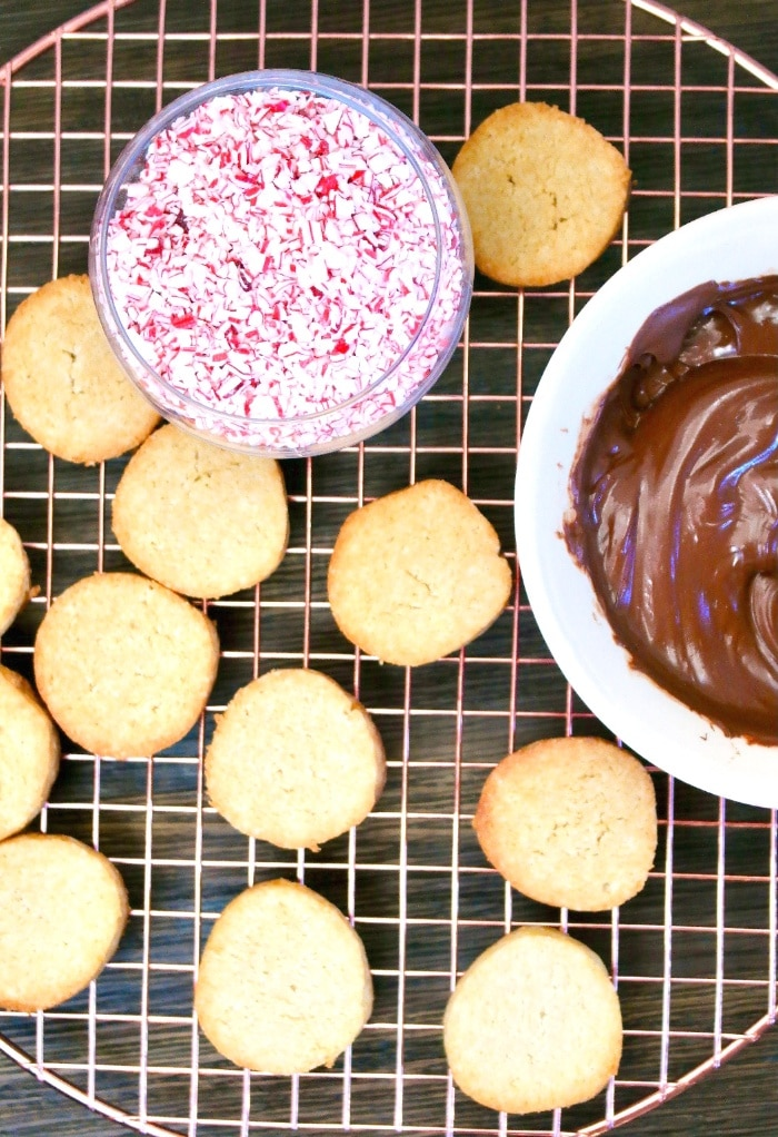 Baked cookies ready to be dipped in chocolate.
