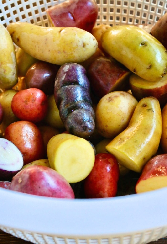Clean fingerling potatoes in a colander.