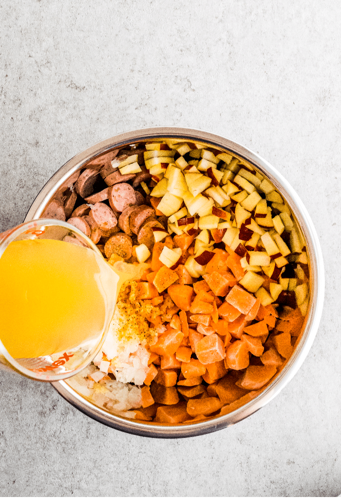 All ingredients added to an Instant Pot to make sweet potato breakfast bowls.