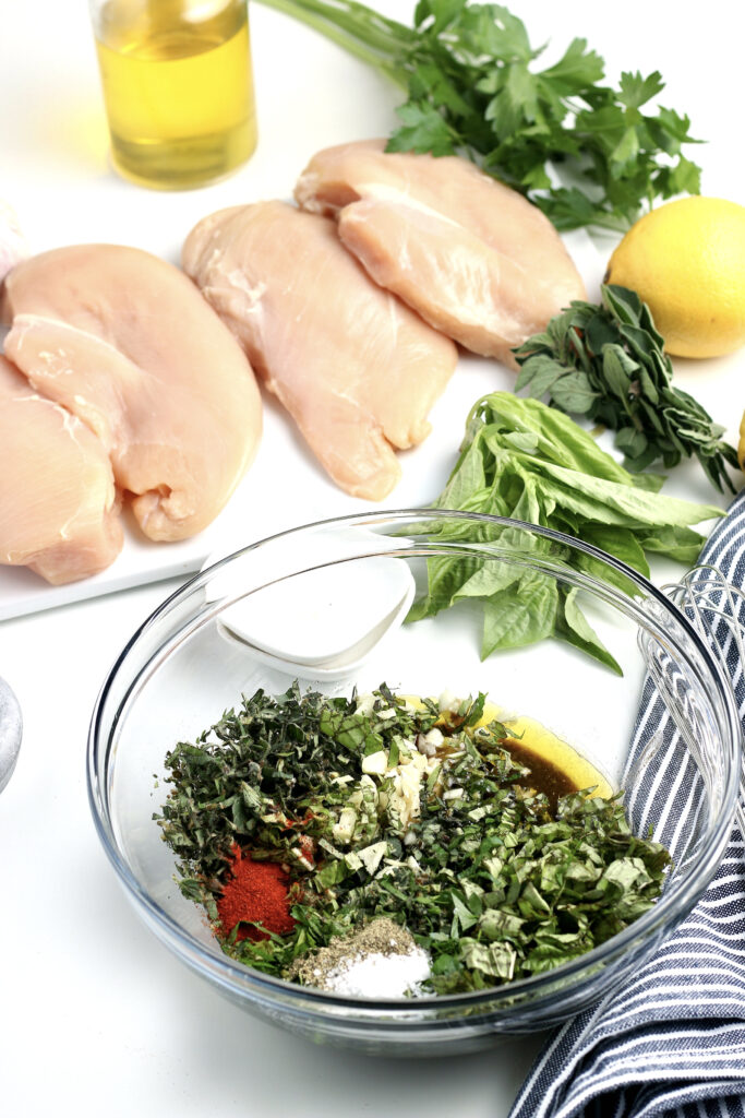 Chicken marinade for chicken breasts in a clear mixing bowl.