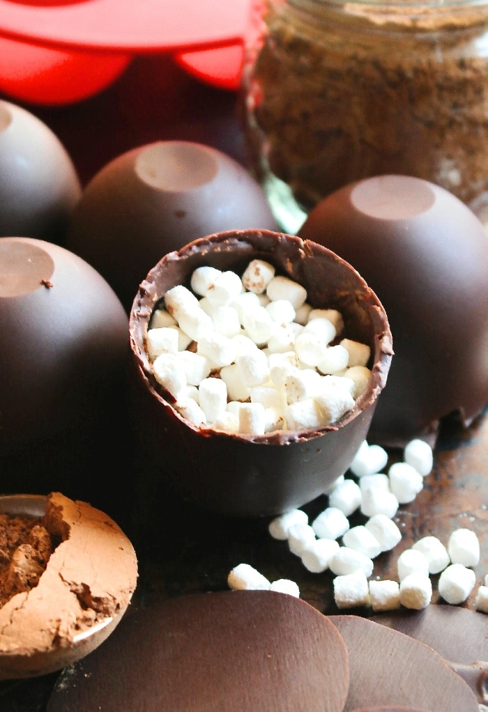 Cocoa and mini marshmallows in a cocoa bomb.