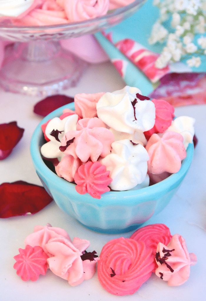 Meringue kisses in a teal bowl ready to enjoy.