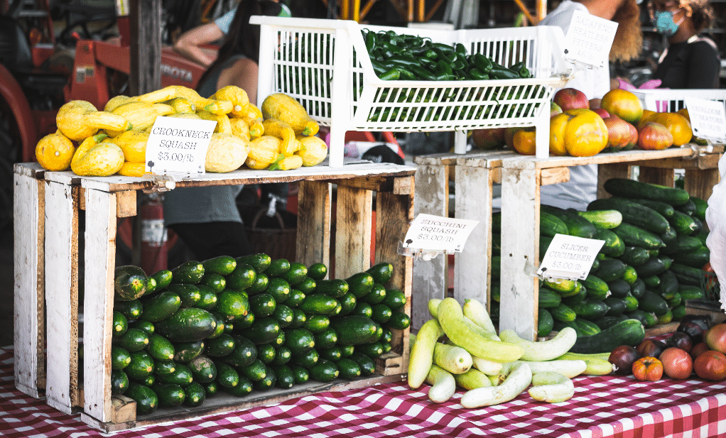 Fresh zucchini at a produce stand ready to purchase.