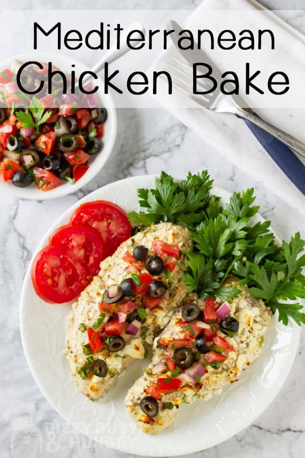 top view of two cooked skinless chicken topped with olive salsa and side of tomato slices- low carb chicken recipes