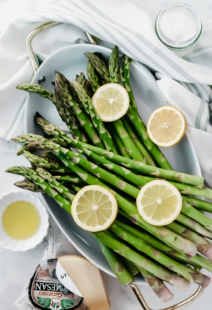 Fresh asparagus topped with lemon slices.