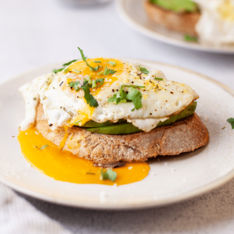 Close view of sunny side egg over toast.