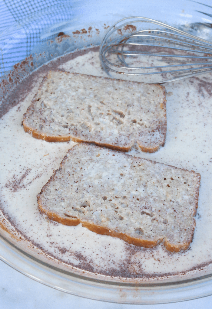 Here we dip the low carb banana bread in the French toast egg mix.