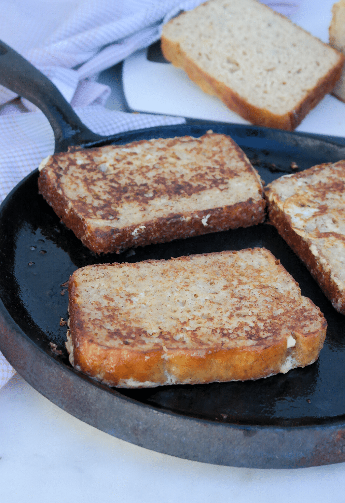 Cooking French toast on an iron skillet.