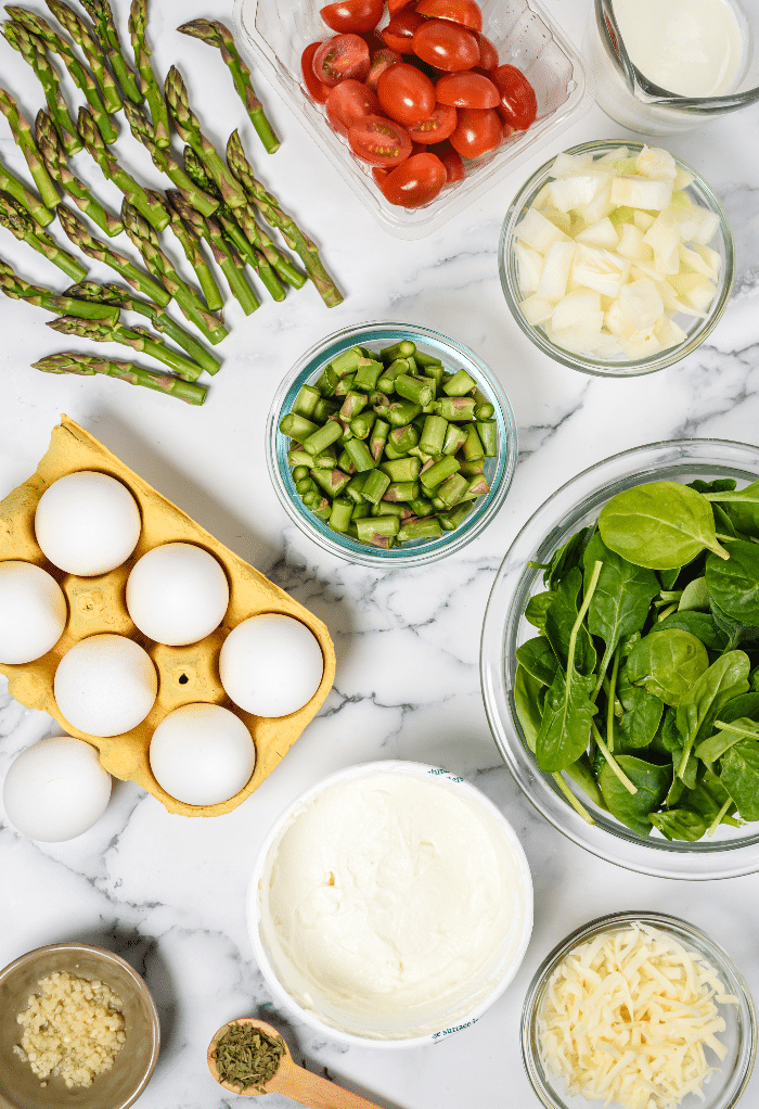 Ingredients to make a keto frittata with spinach and asparagus.
