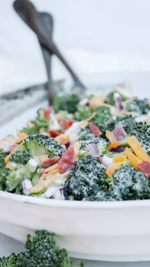 Classic broccoli salad in a white ceramic bowl.
