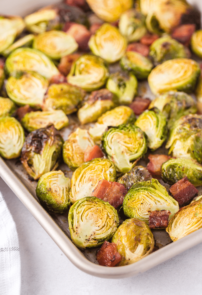 A baking tray of cooked keto Brussels sprouts.