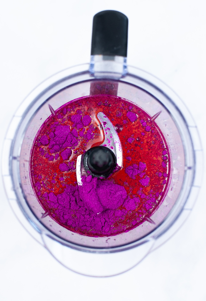 Top view of mango dragonfruit refresher beverage in a blender.