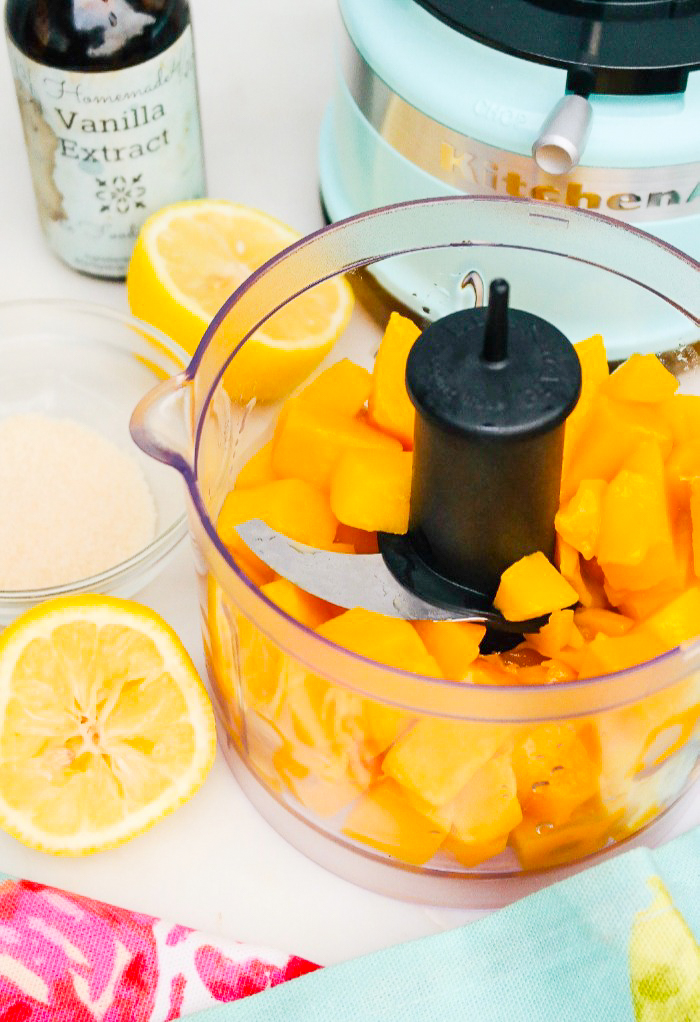 Diced mango in a food processor.