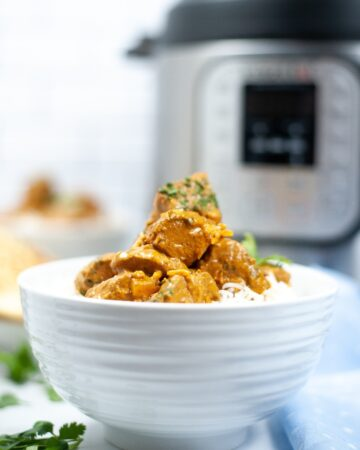 Butter chicken in a white bowl made in an Instant Pot.