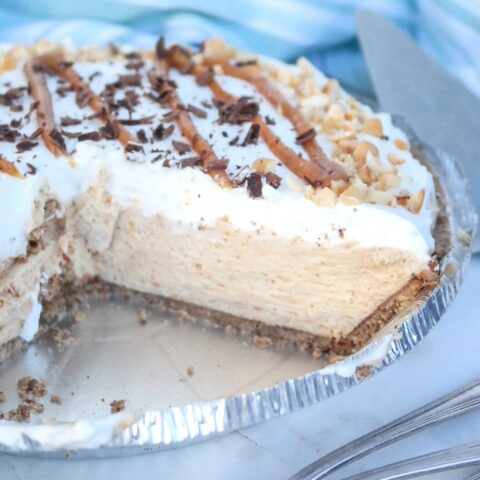 Peanut butter pie with a slice removed.