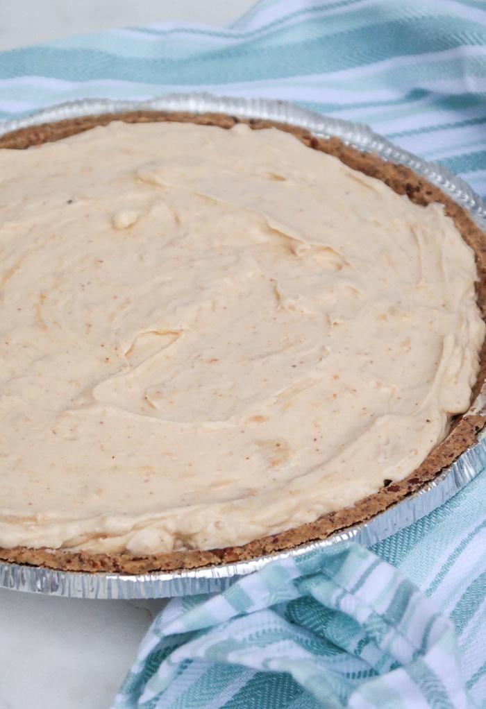 Peanut butter pie filling in a prepared pie crust.