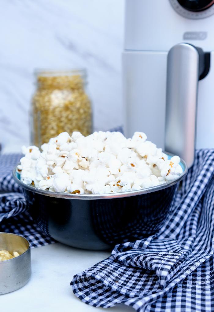 Air fryer popcorn in a black serving bowl.