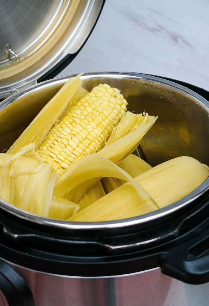 Cooked corn on the cob in a pressure cooker.