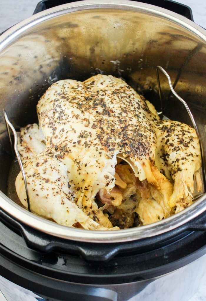 Cooked whole chicken ready to remove from an Instant Pot.