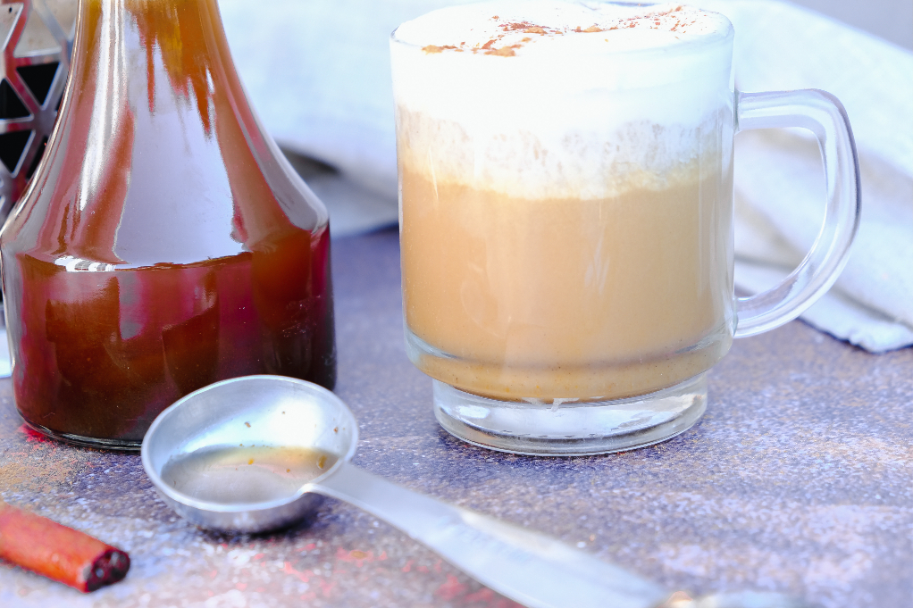 A tablespoon full of syrup to add to coffee as a sweetener.
